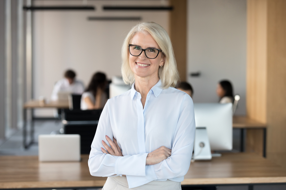 lawyer talking to female colleagues about how to grow a law firm