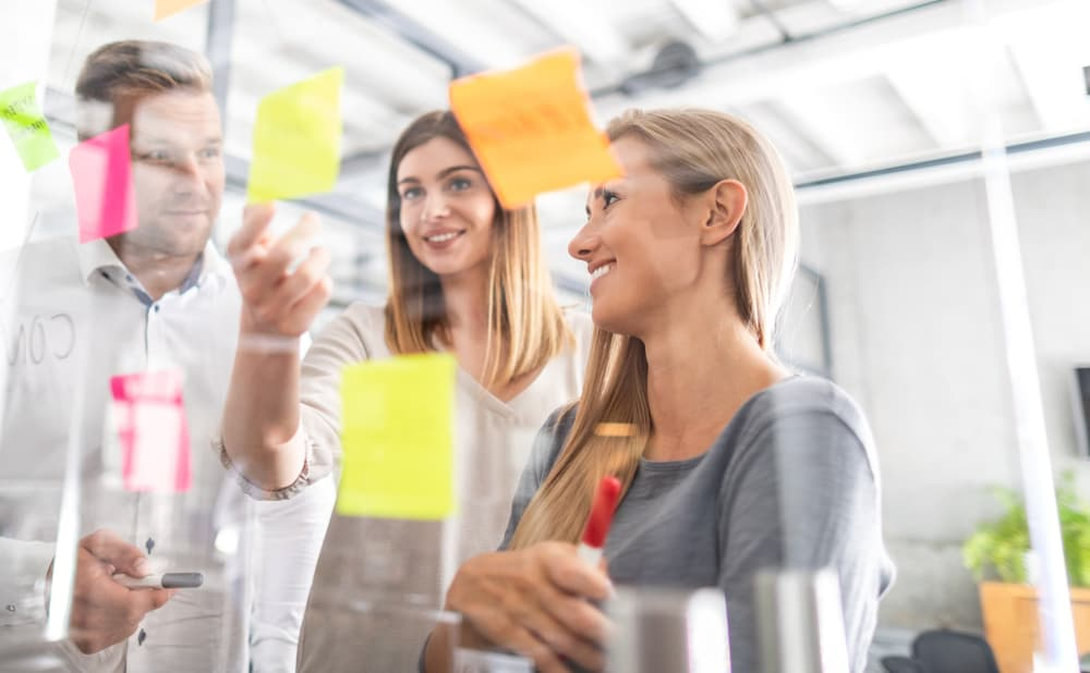 business people have a meeting using post it notes to share ideas