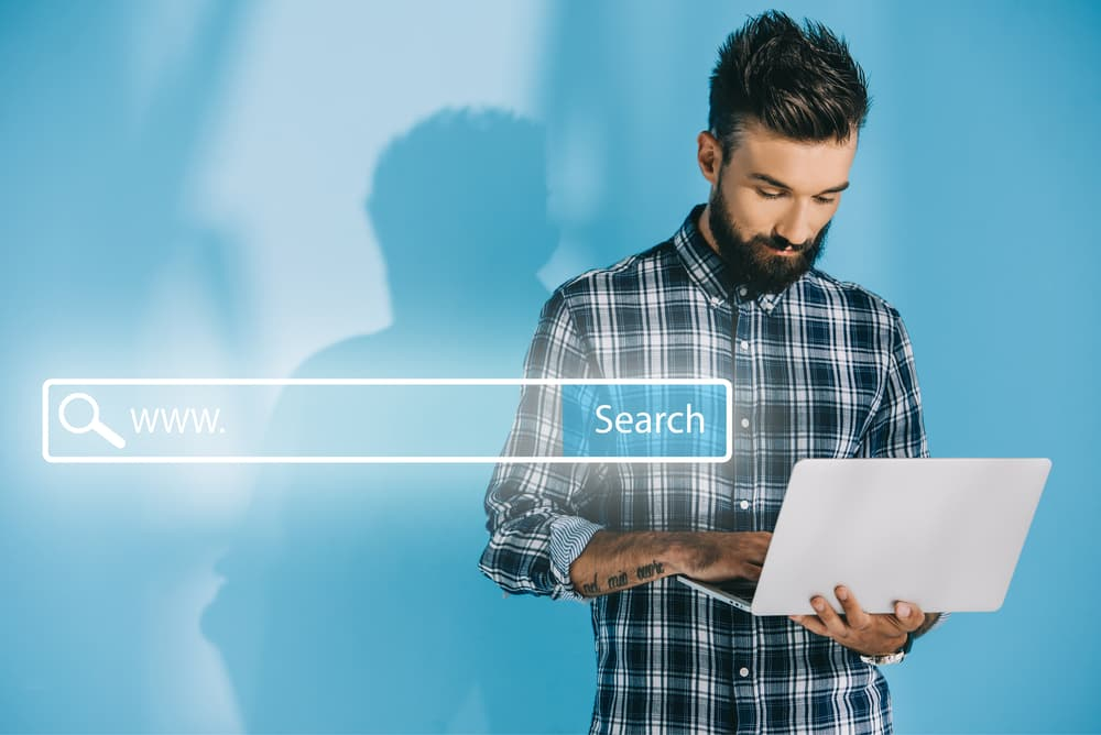 man holding computer searching for law firm seo