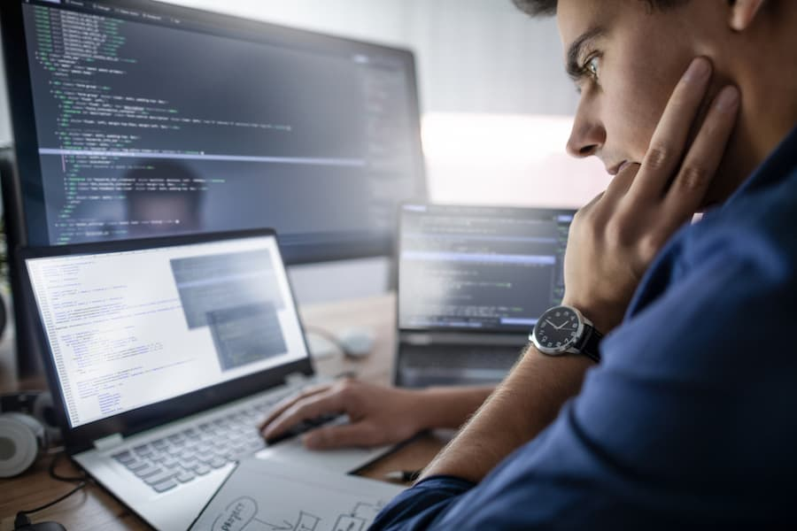 Website developer on laptop working on web design for law firm